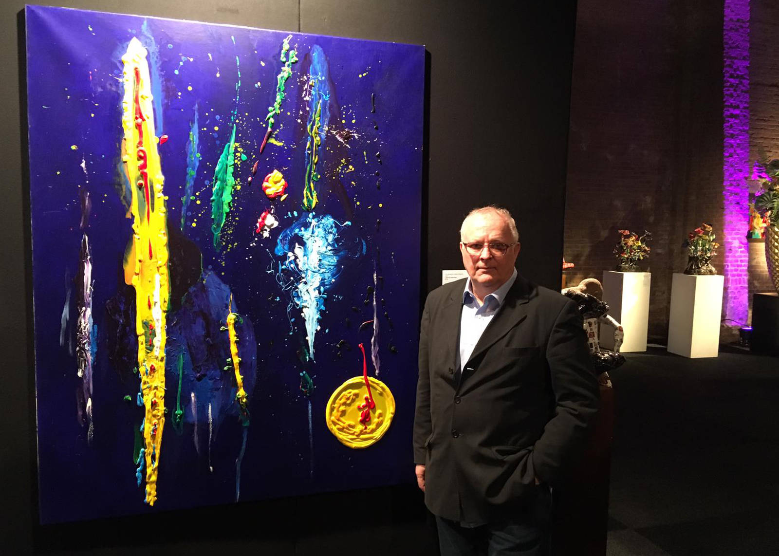"Tom standing next his painting to ""I Want To Break Free"" at the Biënnale Veghel 2018 exhibition"
