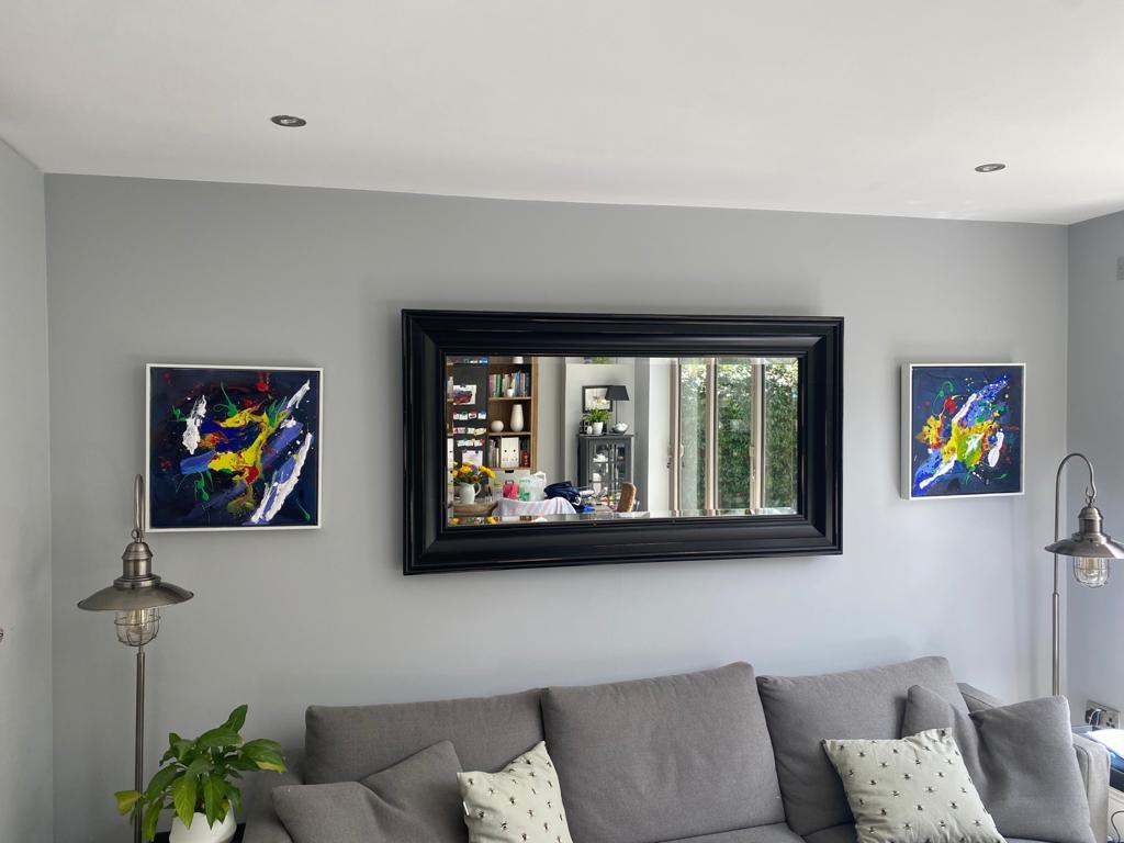 Two paintings framed in situ